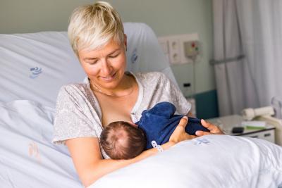 Mom breastfeeding her newborn baby boy in a hospital