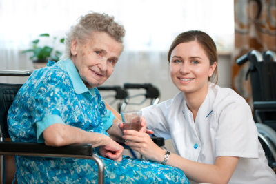 elder woman smiling with caregiver