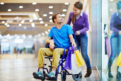 Caregiver and her patient shopping inside the mall